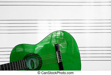 green Spanish guitar - detail of a green Spanish guitar and...