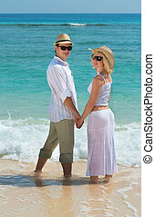 Happy young couple enjoying at beach - Happy young couple in...