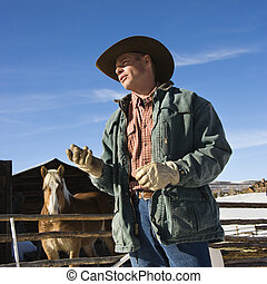 Wrangler talking. - Middle-aged Caucasian male wrangler with...