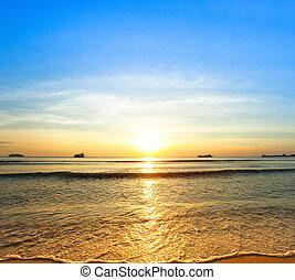 Sunset on coast sea.