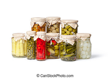 Preserved vegetables on white background