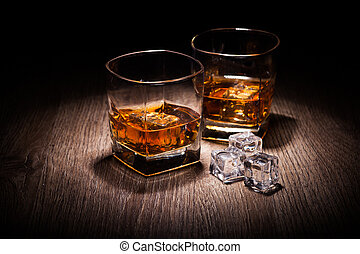 whiskey in glass on wooden table