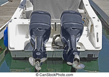Dual outboard motors - Rear view of white motorboat, 2...