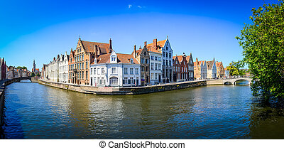 Panorama view of river canal and colorful houses in Bruges,...