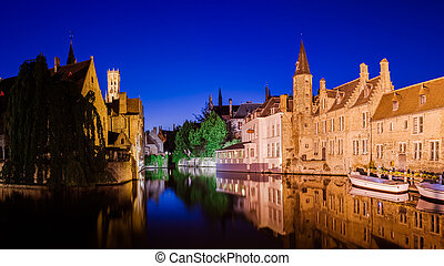 River canal and medieval houses at night, Bruges - River...