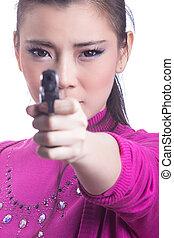 woman aiming a gun - Beautiful young woman aiming a gun
