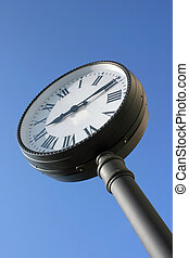 Street clock against blue sky with copy space