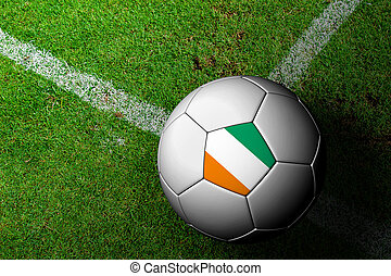 Ivory Coast Flag Pattern of a soccer ball in green grass