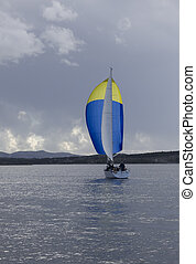 Yacht with blue spinnaker - Yacht with blue and yellow...