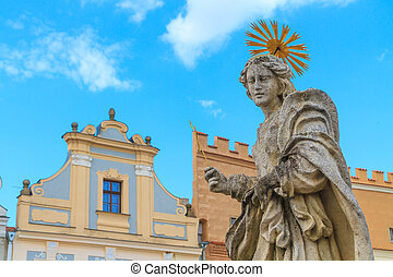 Facade of Renaissance houses and Holy Mary Statue in Telc,...