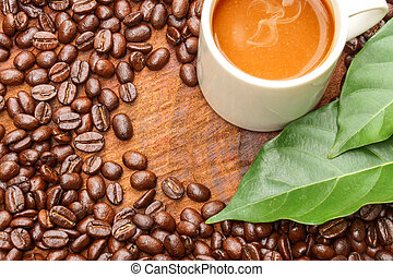 Coffee and beans on the wooden background