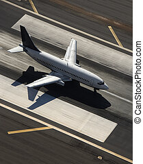 Airplane on runway - Aerial view of passenger airplane on...