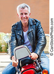 Smiling Caucasian biker back front - Color vertical portrait...
