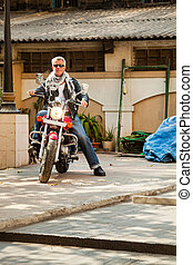 Portrait of Motor biker Industrial location - Color vertical...