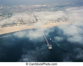 California beach. - Aerial view of clouds covering...