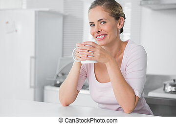 Radiant woman having coffee