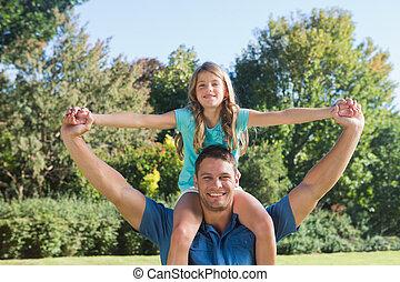 Daughter sitting on dads shoulder