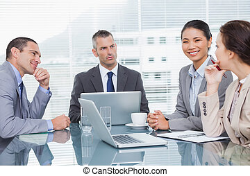 Business people working together over coffee