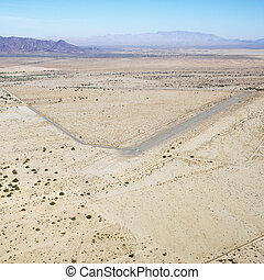 Landing strip in desert. - Aerial view of remote landing...