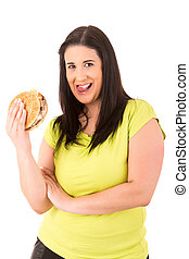 Diet Concept - Beautiful large woman, trying to resist to an...