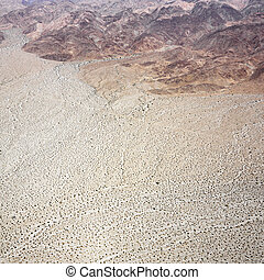 Desert with mountains. - Aerial view of torrid California...