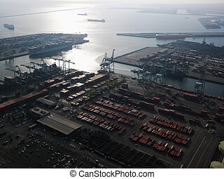 Aerial of shipping dock. - Aerial view of dock with cargo...