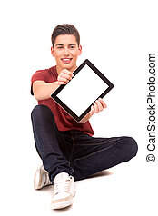Young boy - Happy young boy presenting your product in a...