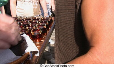 Waiter serving wine and cake - Tray full of glasses of wine...