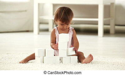 Building blocks - Lovely child playing with building blocks...