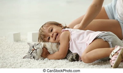 Cuddling with cat - Cute girl cuddling with her furry friend