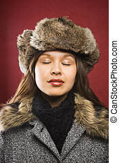 Woman in fur hat - Young adult Caucasian woman wearing fur...