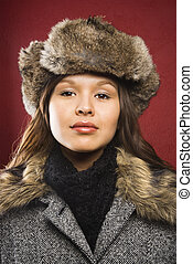 Woman in outerwear - Young adult Caucasian woman wearing fur...