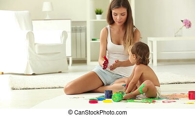 Handprints - Charming babysitter and a little girl making...