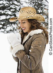 Cowgirl drinking coffee - Caucasian young adult female...