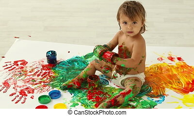 Messy activity - Lovely toddler having a good time making a...