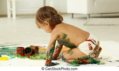 Messy - Cute child playing with paints making quite a mess