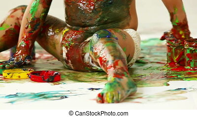 Covered in paint - Close-up of a tot covered in gouache from...