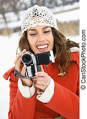 Woman with video camera.