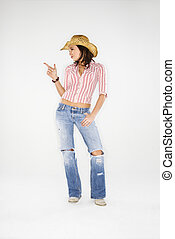 Cowgirl with imaginary gun. - Young adult Caucasian woman...