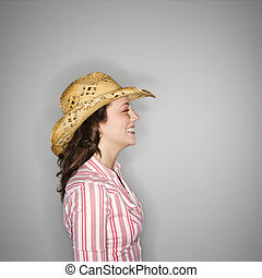 Cowgirl profile - Profile of young Caucasian woman wearing...