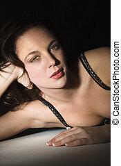 Pretty woman in bra - Sexy Caucasian woman in bra lying on...