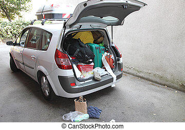 Car full of suitcases and bags to return from holidays - Car...
