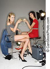 Women toasting wine.