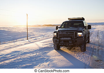 Truck on icy road. - Truck on ice covered road and snowy...