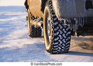 Truck on icy road. - Close up of truck on ice covered road.
