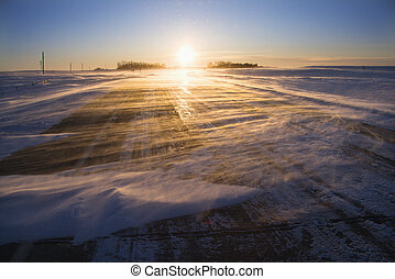 Ice on road at sunrise. - Ice covered road with sun rising...