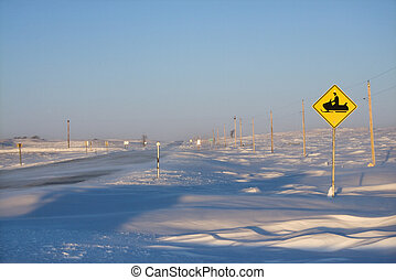 Snowmobile crossing sign.