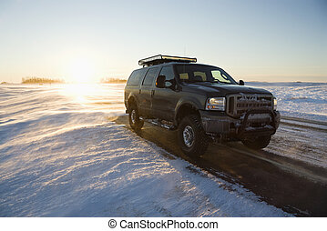Truck on icy road. - Truck on icy road with snowy landscape.