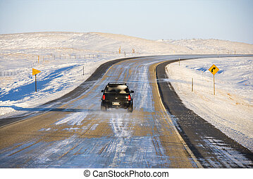 Automobile on icy road - SUV on icy road in snowy landscape...