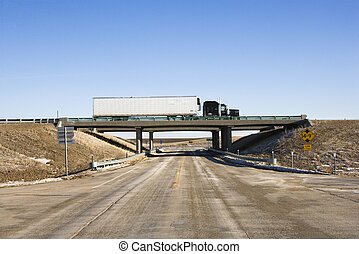 Truck on overpass. - Tractor trailer truck on overpass.